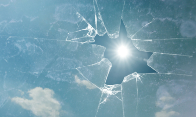 Broken glass with the sun visible through the hole